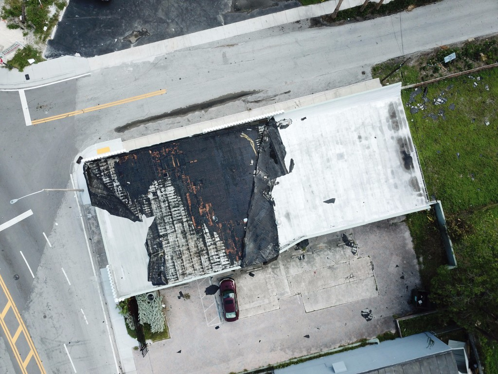 Drone photography of Hurricane Irma damaged .CLUB Domains Office Rooftop in Fort Lauderdale, Florida